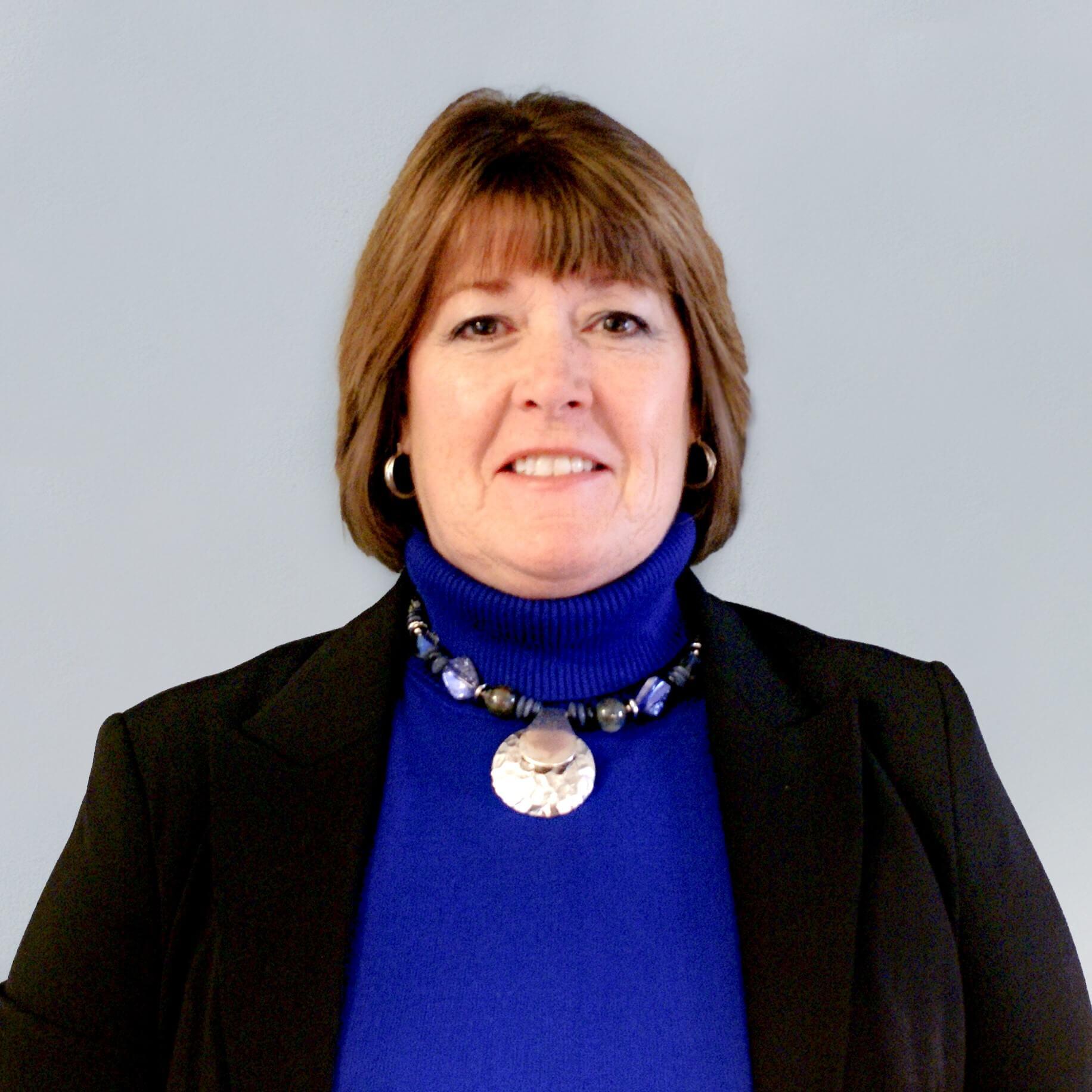 Carol-Headshot-Lt-Blue About Us tax preparation 60174