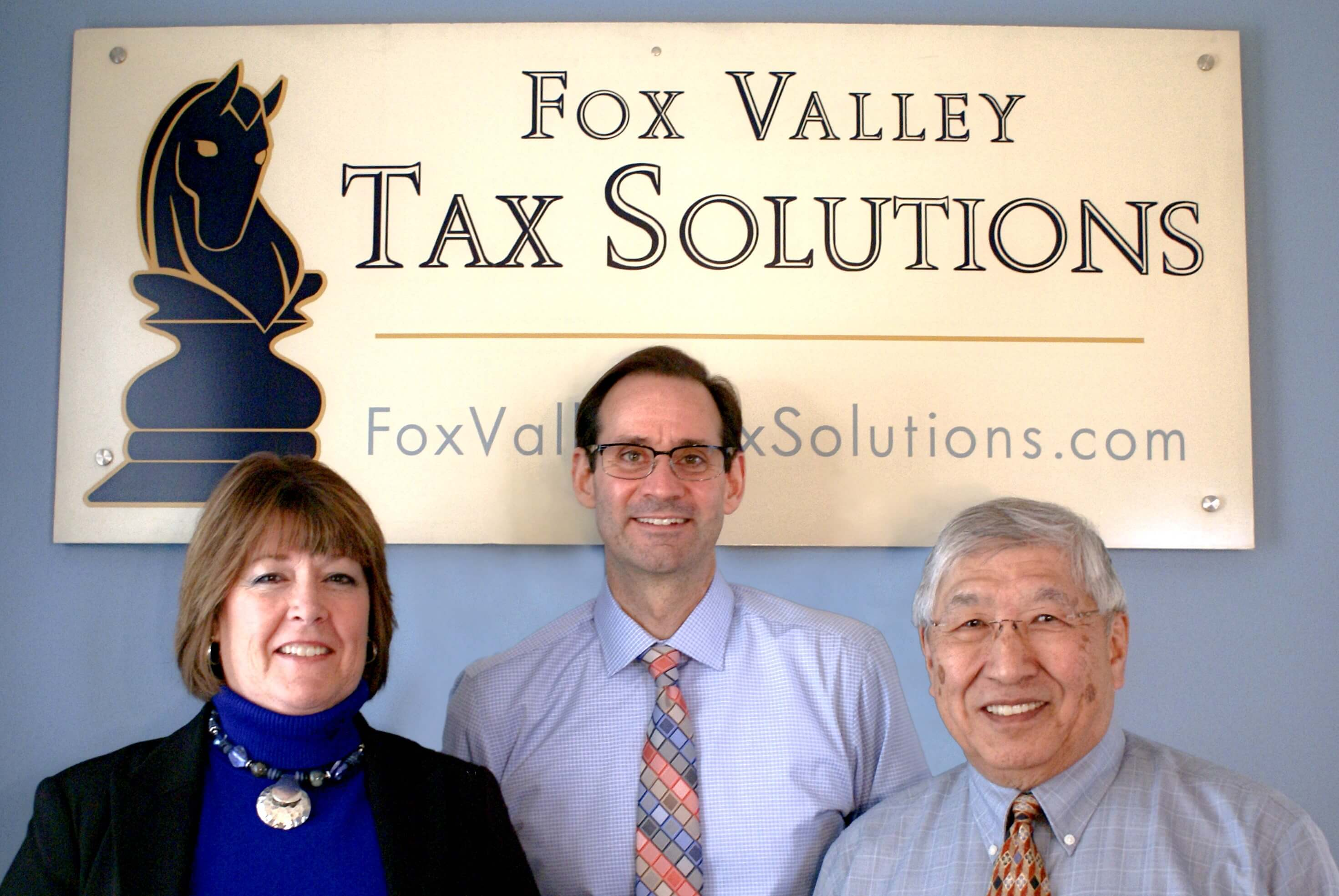 Group-Pic-with-sign About Us tax preparation 60174